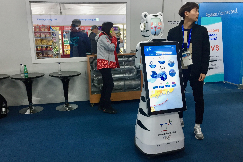 Même au village olympique, les robots sont de sortie.