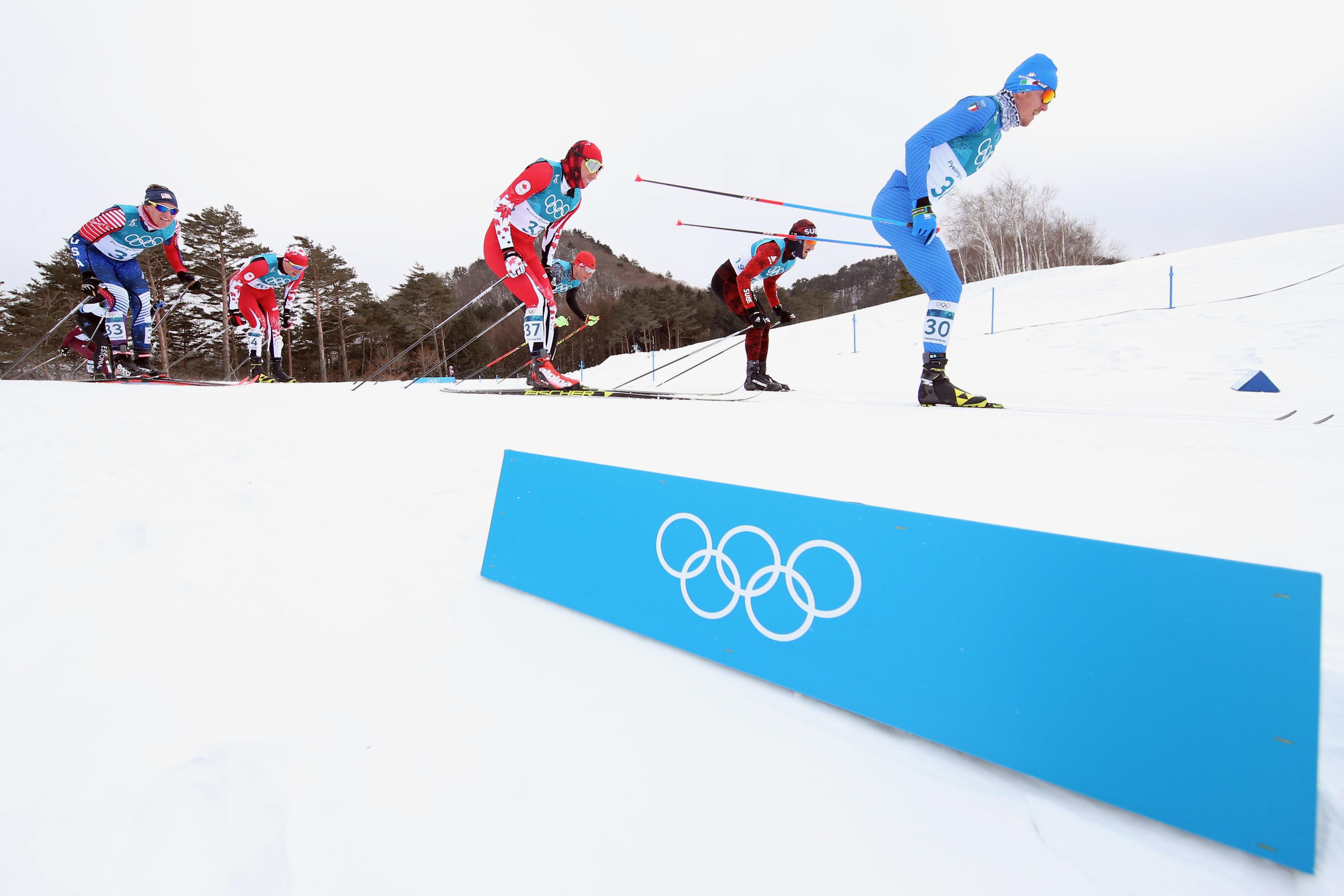 Dietmar Nöckler (à dr.), lors du skiathlon.